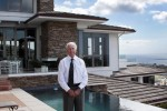 Broker Michael Gosselin at one of his ocean-front listings, on the market several years ago at $5.9 million, was put up for sale again at $4.6 million.