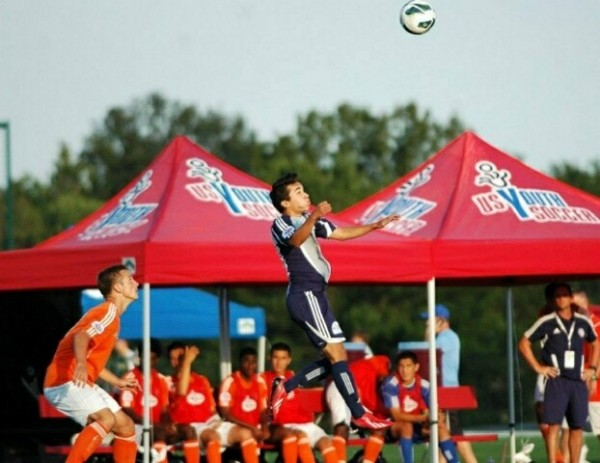hris Tellez heads the ball during the national tournament.